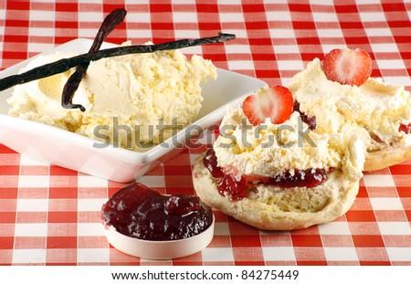 split strawberry cream scone, with cream and jam - stock photo