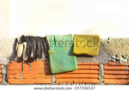 Sponge cloth gloves put on the wall - stock photo