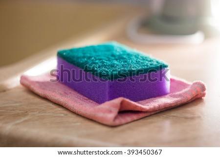 sponge for ware washing, selective focus - stock photo