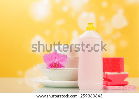 Sponges for washing dishes, flower and cleaner - stock photo
