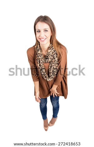 Spontaneously laughing woman looking at camera. High angle view wide lens full body length portrait isolated over white background - stock photo