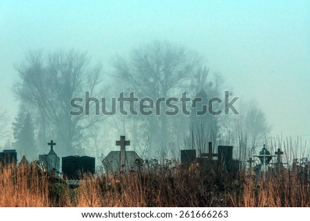 spooky cemetery in nigth time - stock photo