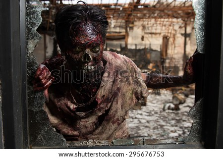 Spooky, creepy zombie in clothes, The scary zombie who gets burned,Man who burned the Horror of a in the pub. - stock photo