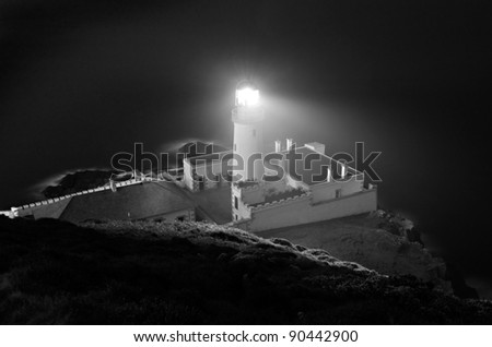 Spooky Douglas Head Lighthouse at Night on the Isle of Man. Black and White photo with Long exposure effect - stock photo