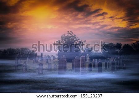 Spooky graveyard and fog - stock photo