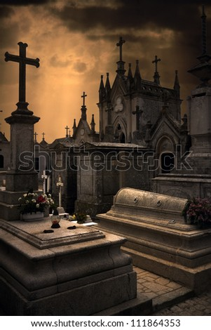 Spooky Halloween european graveyard with dark clouds - stock photo