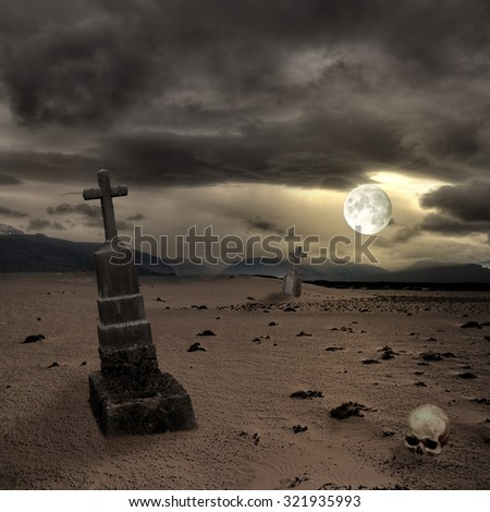 Spooky Halloween graveyard with dark clouds - stock photo