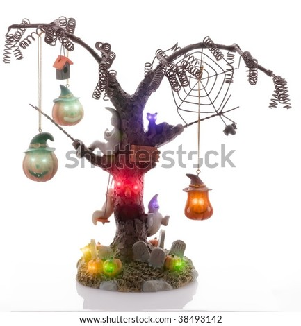 Spooky Halloween tree with Jack O'Lanterns, ghosts and cats. - stock photo