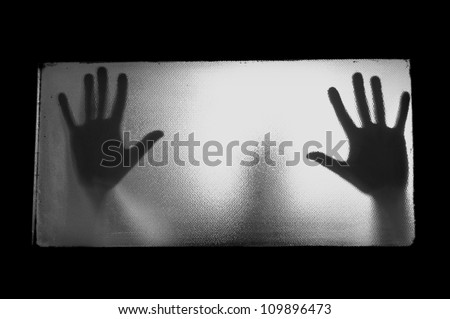Spooky man behind glass. Hands and blurry human figure abstraction. - stock photo