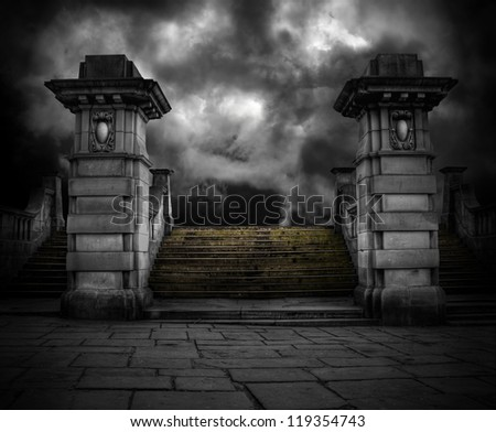 Spooky old sandstone graveyard entrance - stock photo