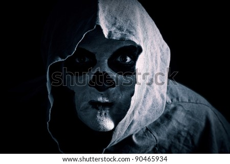 spooky zombie in a hood, low key - stock photo