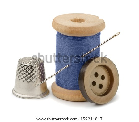 Spool of blue thread, needle, button  and thimble isolated on white - stock photo