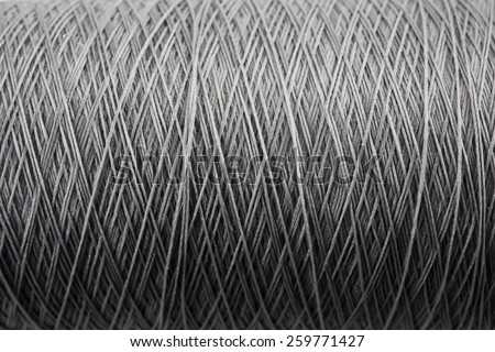 Spool of grey thread high magnification macro. - stock photo
