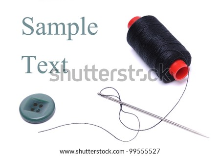 Spool of thread and needle isolated on white - stock photo