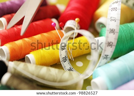 Spool of thread and pins. Sewing accessories - stock photo