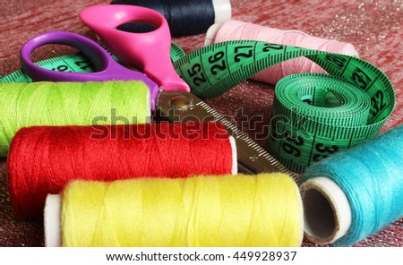 Spool of thread and scissors. Sewing accessories. - stock photo