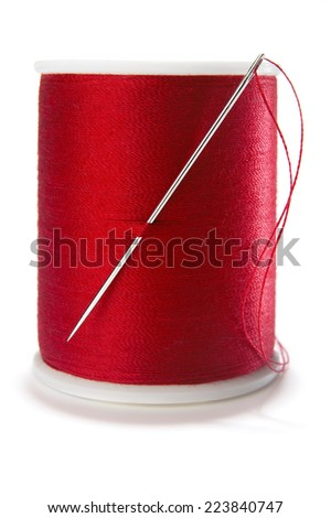 Spool of Thread and Sewing Needle - stock photo