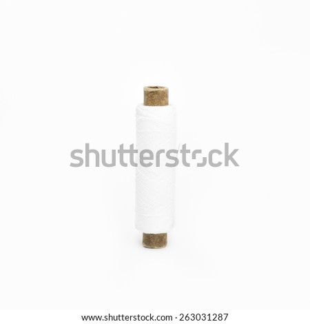 Spool of thread with needle isolated on  a white background - stock photo