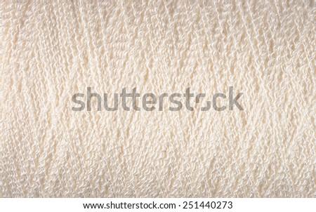 Spool of white thread macro background texture  - stock photo