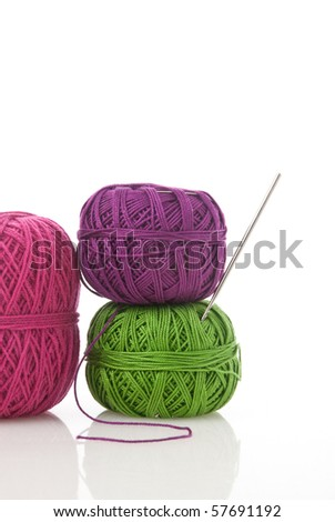 spools of many colors on a white background. - stock photo