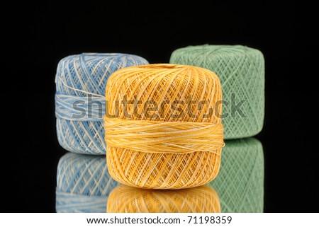 Spools of thread on a mirror - stock photo