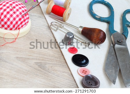 Spools of threads buttons needle for sewing vintage retro style  - stock photo