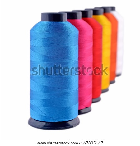 Spools of threads isolated on a white background - stock photo