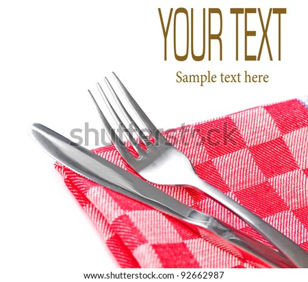 Spoon and knife on a napkin - stock photo