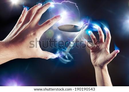 spoon bending, psychokinesis, power of the mind - stock photo