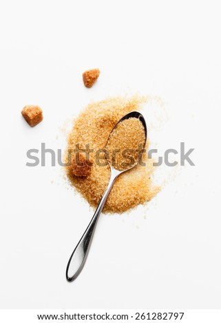 Spoon with brown sugar - stock photo