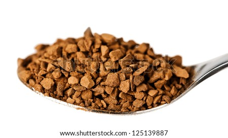 Spoon with coffee, close-up - stock photo