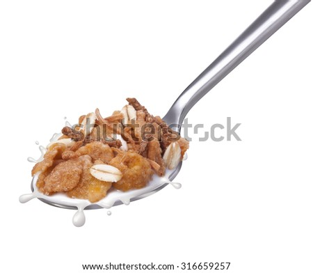 Spoon with corn flakes and granolas with milk splash - stock photo