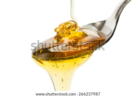 spoon with pouring honey isolated on white background - stock photo