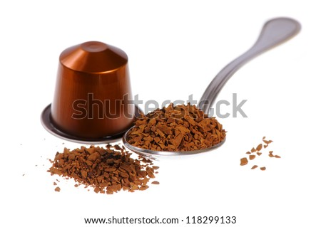 Spoonful of instant coffee granules and capsule, isolated over white background - stock photo
