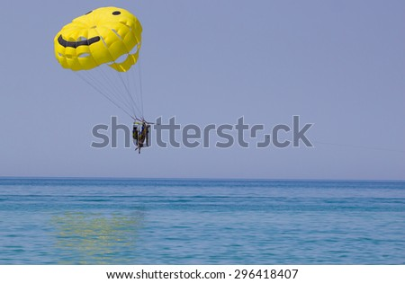 Sport activity - Parasailing smile over the black sea - stock photo