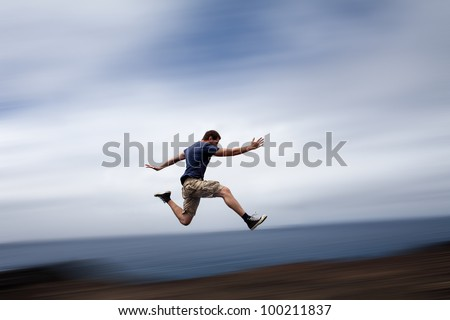 Sport and energy concept - athletic man running fast - stock photo