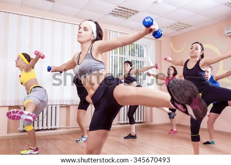 Sport and Fitness Concepts. Group of Young Ladies Having Fitness Training Indoors. Horizontal Image Composition - stock photo
