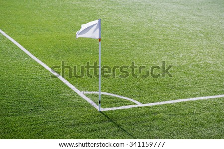 sport and game concept - close up of football field corner with flag marker - stock photo