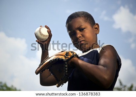 Sport, baseball and kids, portrait of child with glove holding ball and looking at camera - stock photo