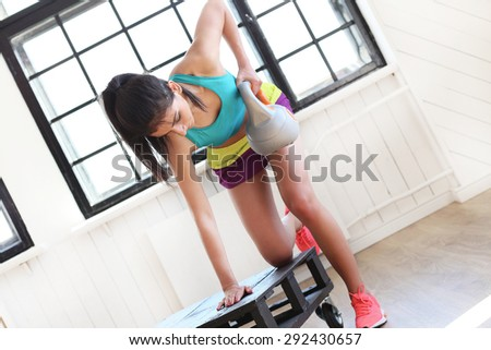 Sport. Beautiful girl in the gym - stock photo