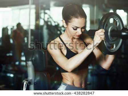 Sport. Beautiful woman in gym - stock photo