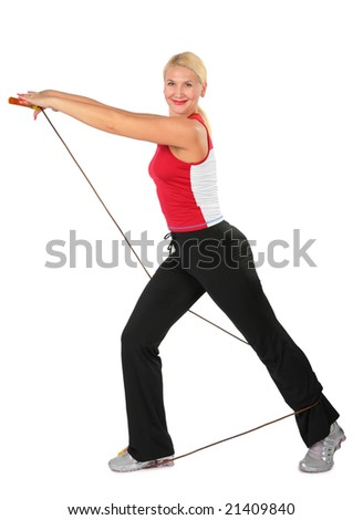 Sport blond makes exercise with rope - stock photo
