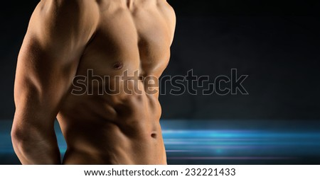 sport, bodybuilding, strength and people concept - close up of male bodybuilder bare torso over dark background - stock photo