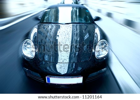 Sport car with special zoom blur effect. Blue tint. - stock photo