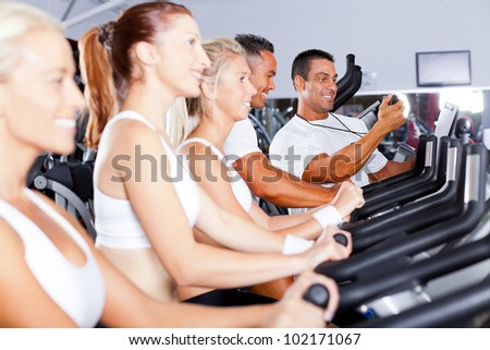 sport coach training cyclists in gym - stock photo