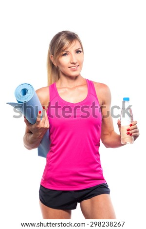 sport concept -beautiful slim sporty woman with yoga mat and water isolated on white background - stock photo
