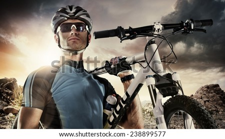 Sport. Cyclist carry a bike on dramatic sky. - stock photo