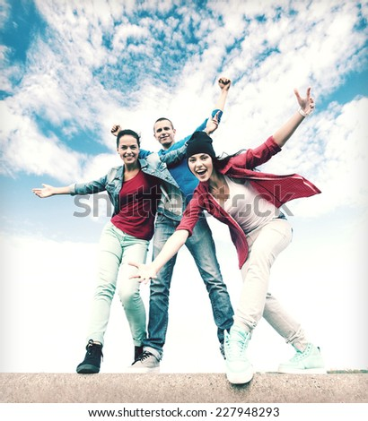 sport, dancing and urban culture concept - group of teenagers dancing - stock photo
