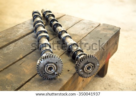 Sport engine camshafts isolated on wood panels. - Selective Focus - stock photo
