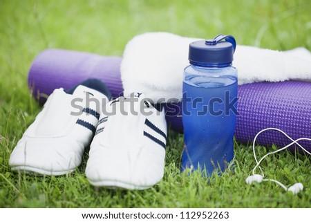sport equipment on a grass - stock photo